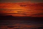 Farbenspiel am Himmel beim Sonnenuntergang auf dem Meer
