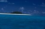 Insel im Pazifik mit schneeweißem Strand